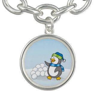 Kleiner Pinguin mit dem Schneeballwellenartig Armband