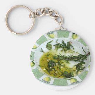 Knoblauch und Kraut hineingegossenes Olivenöl Schlüsselanhänger