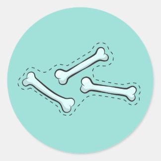 Knochen geworfen runder aufkleber