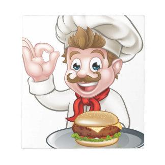 Koch, der Burger hält Notizblock