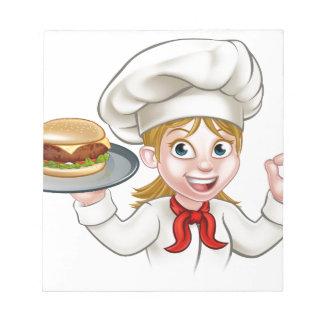 Kochs-Frauen-Cartoon-Charakter, der Burger hält Notizblock