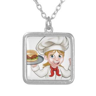 Kochs-Frauen-Cartoon-Charakter, der Burger hält Versilberte Kette