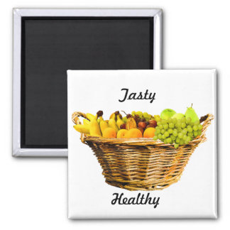 Körbe der Früchte mit den gesunden und Quadratischer Magnet
