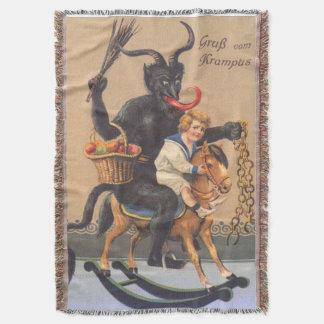 Krampus, das Hobbyhorse mit Jungen reitet Decke