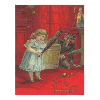 Krampus, das mit Mädchen spielt Postkarte