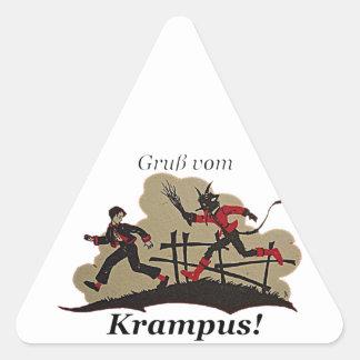 Krampus jagt Kind Dreieckiger Aufkleber