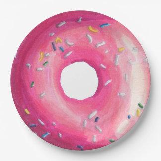 Krapfen mit rosa Zuckergusse und besprüht Pappteller