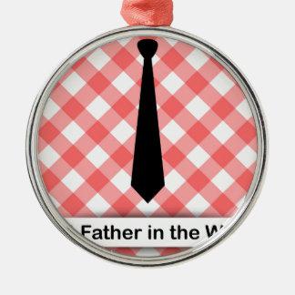 Krawatte auf einem roten Ginghammusterhintergrund Rundes Silberfarbenes Ornament