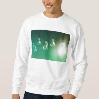 Kreative Innovation und glühendes Konzept als Sweatshirt