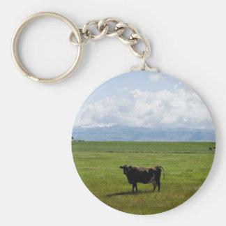 Kuh auf einem Gebiet Schlüsselanhänger
