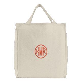 Kundenspezifisches Kreis-Monogramm KRW in der Bestickte Einkaufstaschen