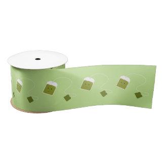 Lächelnder grüner Teebeutel Satinband