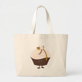 Lächelnder kleiner Kuchen mit Blume und Bogen Einkaufstasche