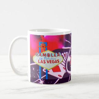 Las Vegas-Zeichen mit Kasino-Würfeln und Rouletten Kaffeetasse