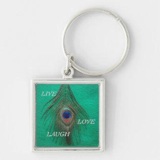 Leben Lachen-Liebe-Pfau-Feder auf grünem kleinem Schlüsselanhänger