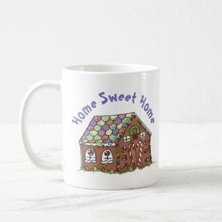 Lebkuchen-Haus-Zuhause-süßes Kaffeetasse