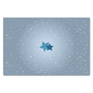 Leuchtender silberner blauer Glitzer hat Seidenpapier