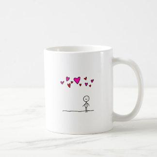 Liebe ist im Luft-Stock-Cartoon Kaffeetasse