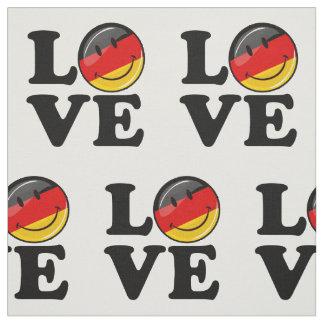 Liebe von lächelnder Flagge Deutschlands Stoff