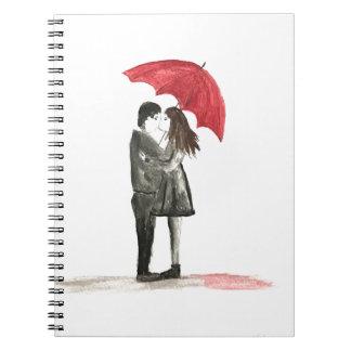 Liebepaare mit rotem Regenschirm Notizblock