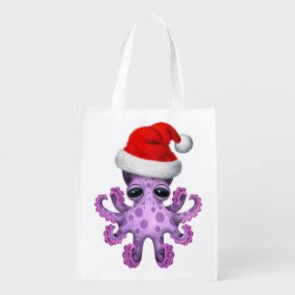 Lila Baby-Krake, die eine Weihnachtsmannmütze Wiederverwendbare Einkaufstasche