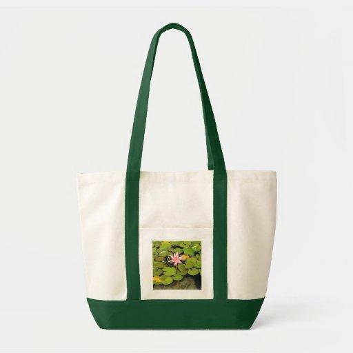 Lilien-Auflagen und rosa Blumen-Taschen-Tasche