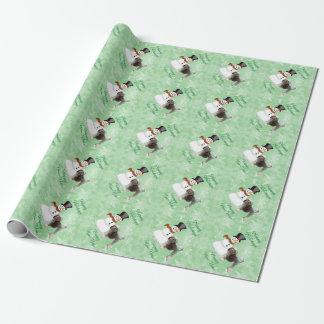 Lowchen mit Schneemann auf grünem Kristall Geschenkpapier