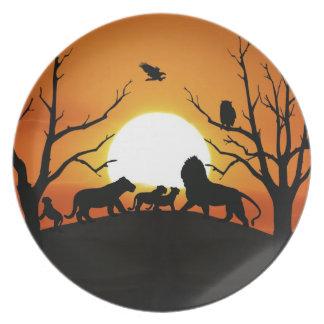 Löwefamilie am Sonnenuntergang Afrika Teller