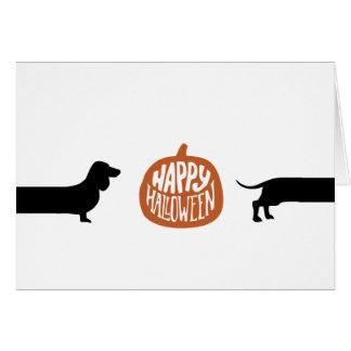 Lustige Dackel mit glücklichem Halloween-Kürbis Karte