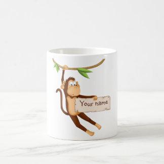 Lustiger Affe, der Ihren Text hält Tasse