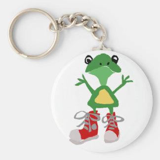 Lustiger grüner Frosch in der roten Schlüsselanhänger