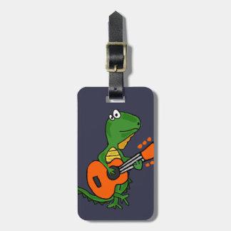 Lustiger Leguan, der Gitarren-Cartoon spielt Kofferanhänger