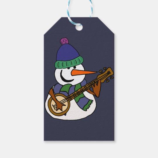 Lustiger Schneemann, der Banjo-Grafik spielt Geschenkanhänger