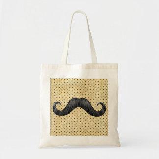Lustiger schwarzer Schnurrbart auf Vintagen gelben Tasche