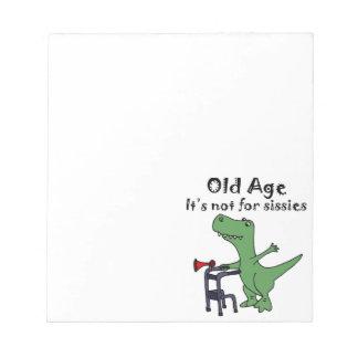 Lustiger T-rex Dinosaurier unter Verwendung des Notizblock