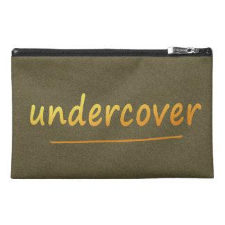 Lustiger Undercover glänzender Text golden auf Reisekulturtasche