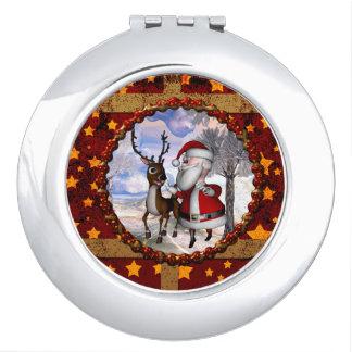 Lustiger Weihnachtsmann mit Ren Taschenspiegel