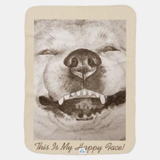 lustiges lächelndes Porträt und Slogan Akitas Babydecke