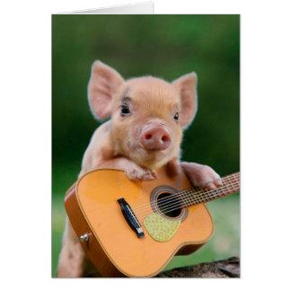 Lustiges niedliches Schwein, das Gitarre spielt Karte