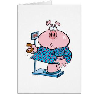 lustiges Schwein auf einer Diät einen Krapfen auf Karte