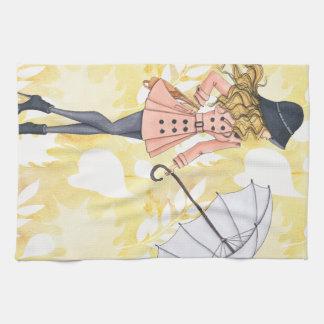 Mädchen mit Regenschirm gegen gelbes Geschirrtuch