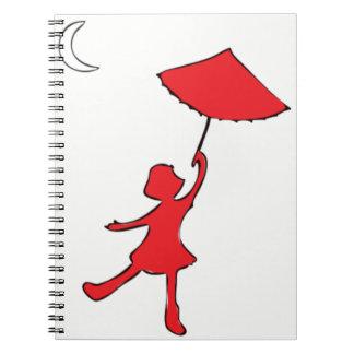 Mädchentanzen mit ihrem Regenschirm Notizblock