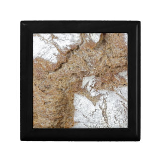 MakroFoto der Oberfläche des braunen Brotes Erinnerungskiste