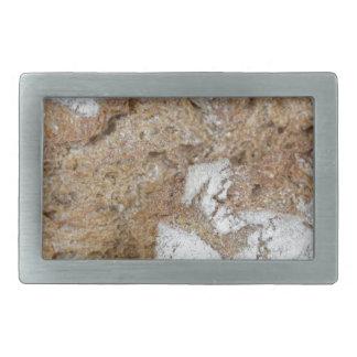MakroFoto der Oberfläche des braunen Brotes Rechteckige Gürtelschnallen