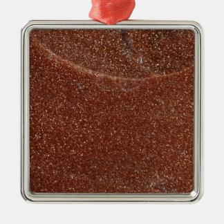 MakroFoto von Goldstone Glas Quadratisches Silberfarbenes Ornament