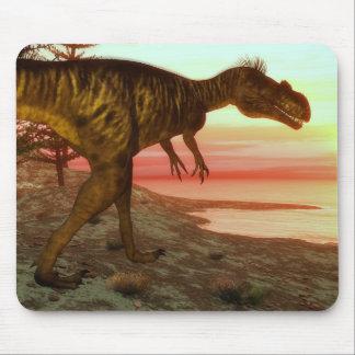 Megalosaurusdinosaurier, der in Richtung zum Ozean Mousepad