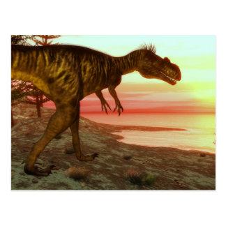 Megalosaurusdinosaurier, der in Richtung zum Ozean Postkarte