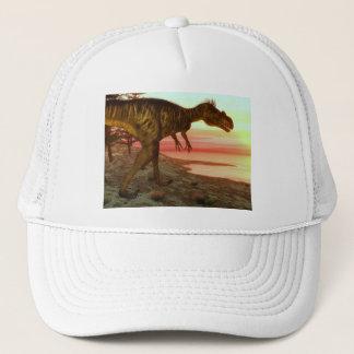 Megalosaurusdinosaurier, der in Richtung zum Ozean Truckerkappe