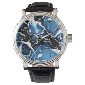 Mehrfaches unregelmäßig geformtes Blau und Uhren