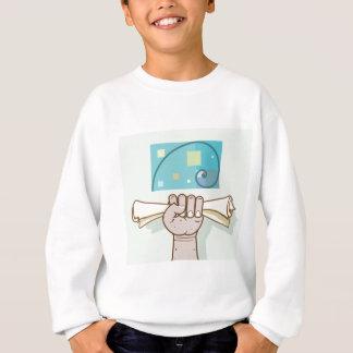 Menschliche Hand hält einen Sweatshirt